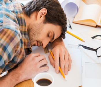 man sleeping on study table
