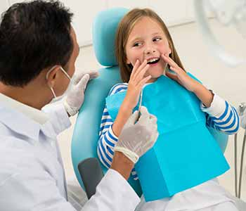 Dr. Ramsin K. Davoud and his staff assess a child's dental health with a physical examination and provide a cleaning.