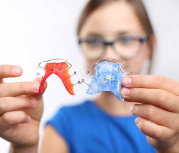 Beautiful smile, orthodontics.Portrait of a little girl with orthodontic appliance